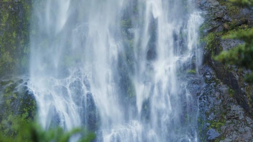 Devils Punchbowl Waterfall of Arthur's Pass in New Zealand; water splashing against rocks; waterfall falling down like silk threads | Shutterstock HD Video #1046937979