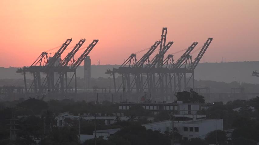 Harbor cranes at dawn. Transport technology. | Shutterstock HD Video #1047081379