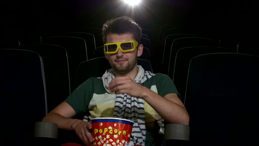 Image result for guy eating popcorn in cinema