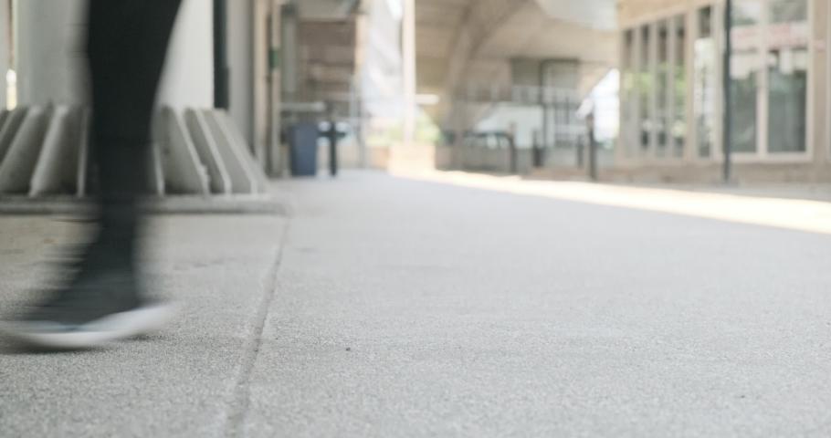 Freestyle dancing in urban street. Asian teenager in sport shoes. | Shutterstock HD Video #1047252529