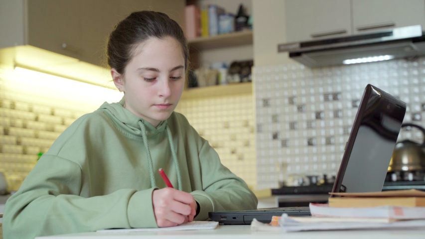 Girl Learning From Home. girl studying online while quarantined at home   Shutterstock HD Video #1048689739