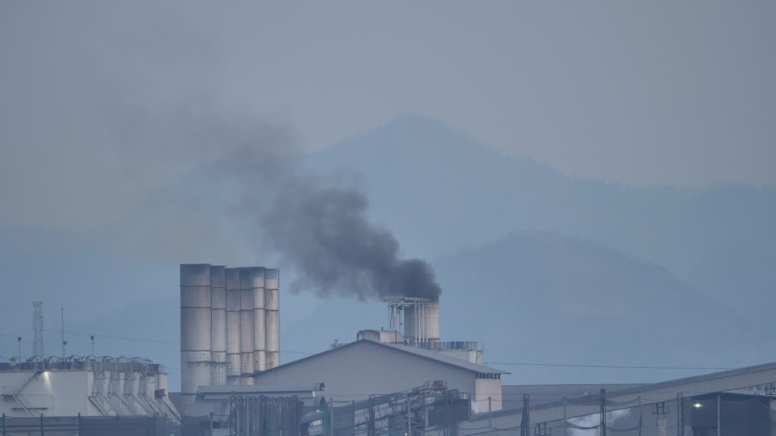 Thailand factory at the countryside at evening time, industry and pollution concept    Shutterstock HD Video #1048836589