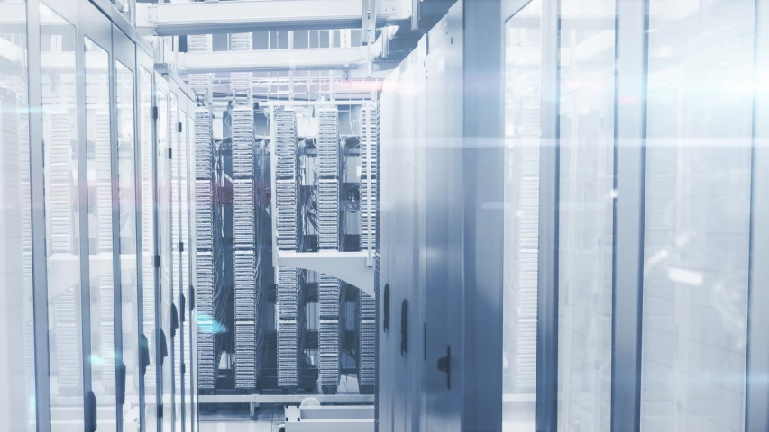 Animation of digital icons, data processing and digital information flowing through network of computer servers in a server room with light trails flashing on surface. Global network of internet | Shutterstock HD Video #1049358889
