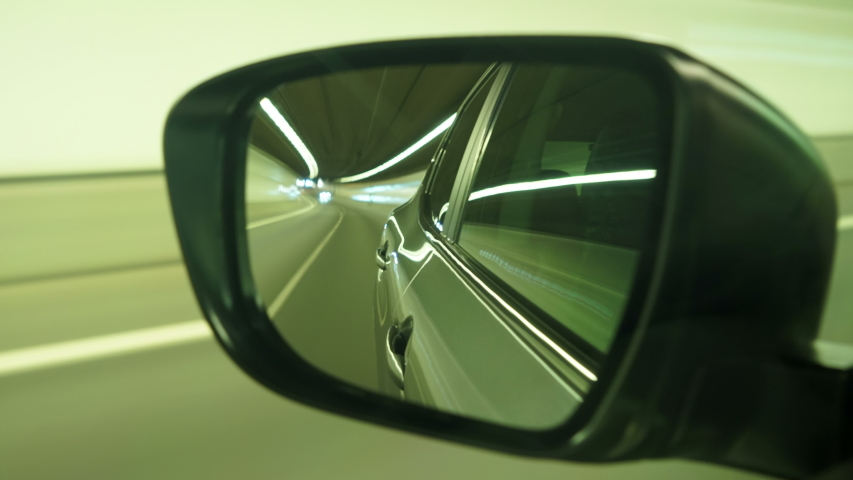 Driving reflection from car side mirror. Shot on raw photos (7360 × 4912)  | Shutterstock HD Video #1049388079