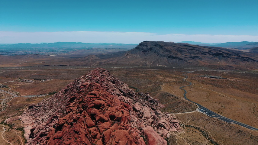 Stunning aerial landscape views of Red Rock Canyon in in Nevada's Mojave Desert near Las Vegas. | Shutterstock HD Video #1049465539