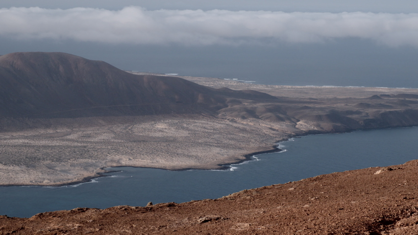 The sea and horizon at La Graciosa, an island in the Canaries. | Shutterstock HD Video #1049612659