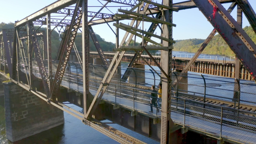 Aerial View, Couple Walking on Historical Harpers Ferry Bridge, West Virginia | Shutterstock HD Video #1049616379