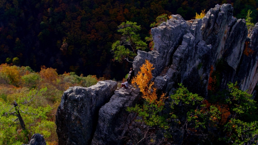 Couple Hiking at Top of Seneca Rocks Peak, West Virginia, Aerial View | Shutterstock HD Video #1049616499