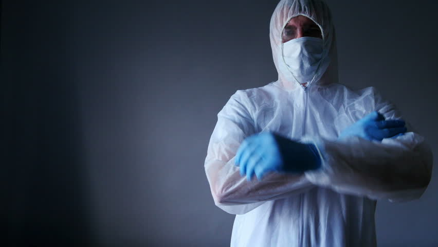 Man in forensic suit and mask, space of text or other elements, 4k, UHD | Shutterstock HD Video #10517249