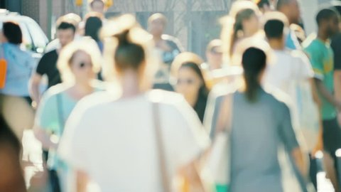 Blurred crowd walking slow motion