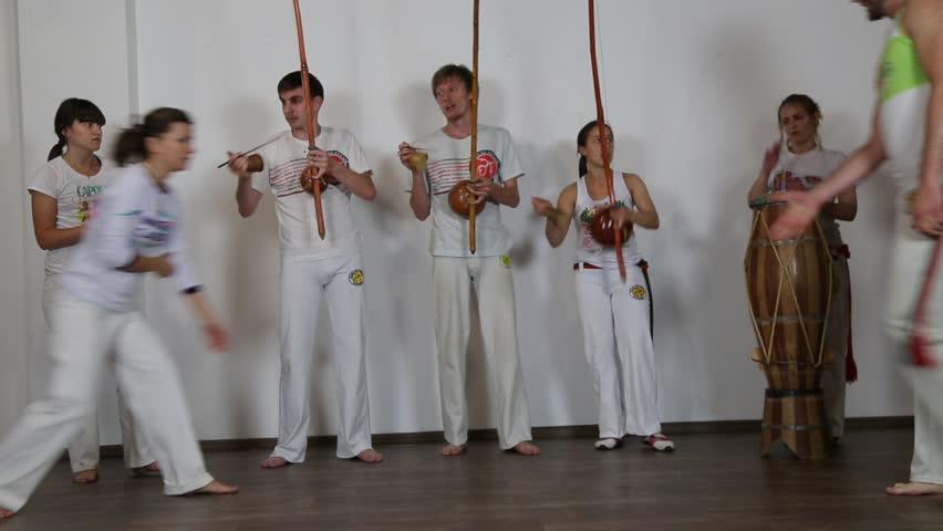 KIEV, UKRAINE – JUNE 23, 2015: Young People Practicing Capoeira