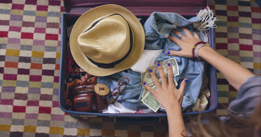 Top view packing vintage suitcase girls planning road trip RED DRAGON | Shutterstock HD Video #10567952