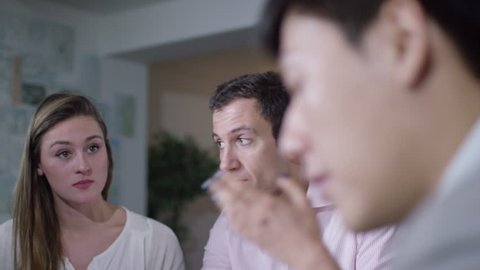 4K Business group in conflict at office meeting