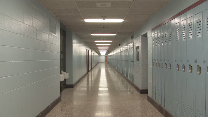 High school hallway. Slow zoom.  Slow zoom down a long, empty high school hallway. Lockers lining the right wall. Shot with Canon XH-A1s.