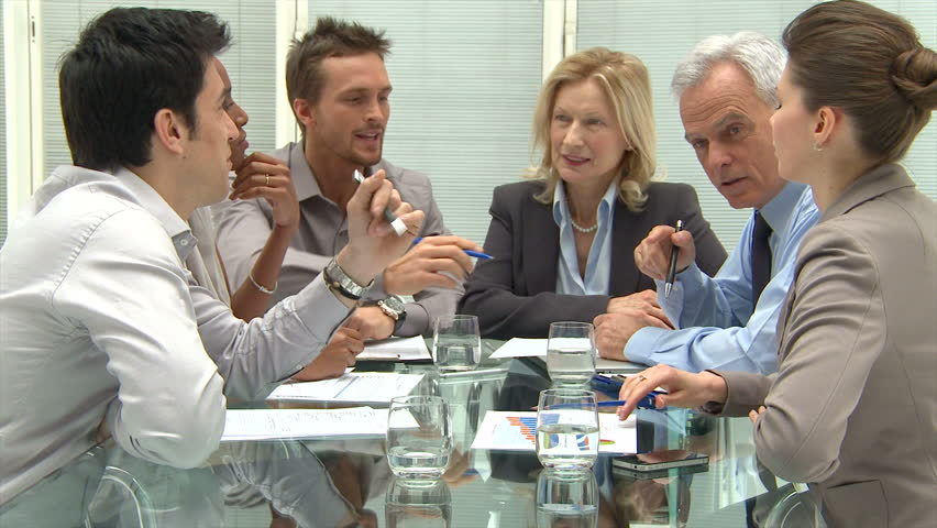 Group Of Coworkers Discussing In Conference Room. Businessmen and businesswomen at business meeting in a conference room. Group of businesspeople working together. | Shutterstock HD Video #10626569