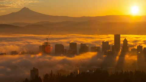 Ultra High Definition 4k Time Lapse Movie of Rolling Fog Low Clouds and Sky with Snow Covered Mount Hood Over Downtown Cityscape of Portland Oregon at Sunrise One Early Morning 4096×2160