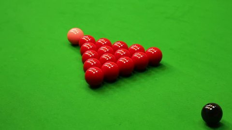 Game of snooker - Cue ball striking the reds at a starting a game of snooker.