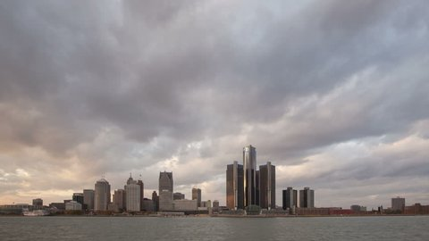 DETROIT, USA - NOV 07, 2013: 4K Time lapse of Detroit city waterfront and skyline at sunset in twilight with clouds passing by