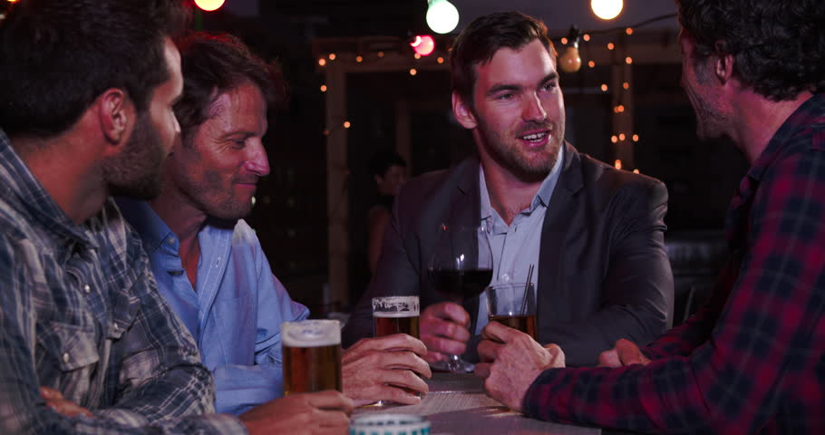 Group Of Male Friends Relaxing Together At Rooftop Bar   Shutterstock HD Video #10689209