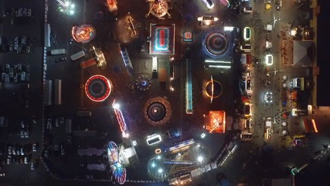 Night time aerial passover of a carnival from overhead