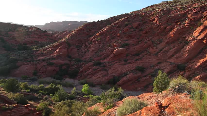 The red rocks of a desert canyon are illuminated by a spring sunset. | Shutterstock HD Video #10721519