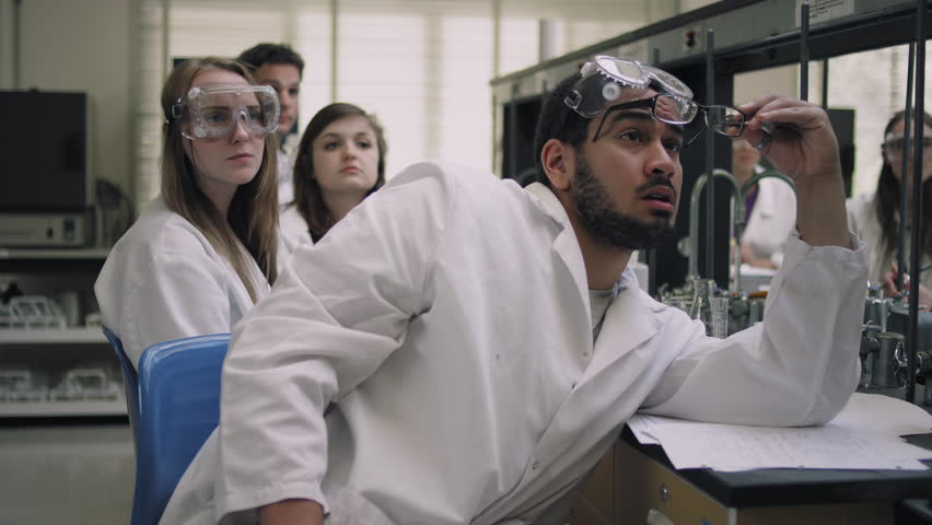 Students in a science lab listen to their professor and raise their hands   Shutterstock HD Video #10723619