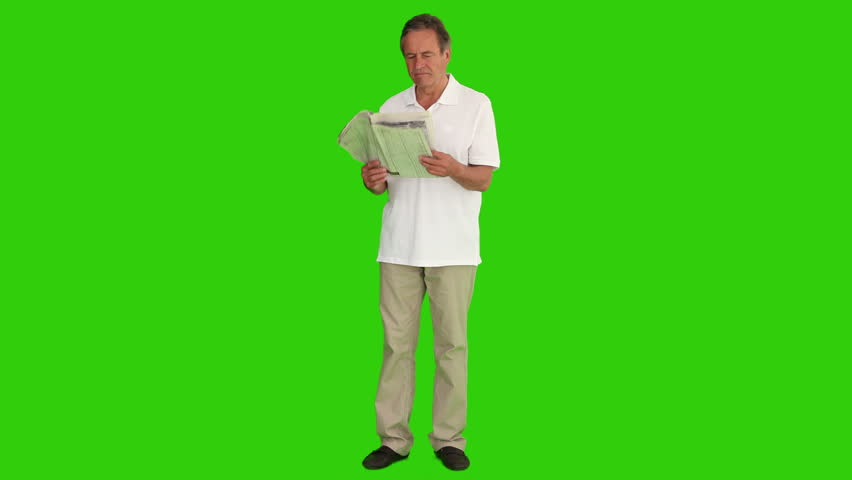 Chroma-key footage of a retired man reading a funny article
