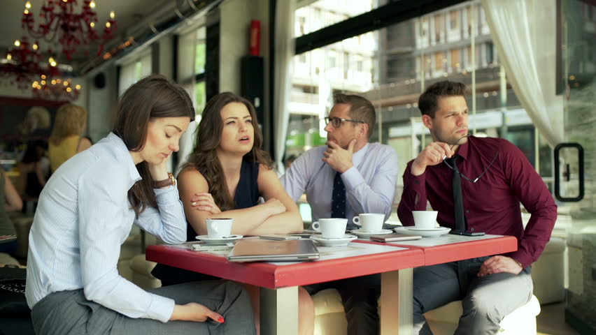 Bored businesspeople sitting in the cafe and not talking  | Shutterstock HD Video #10729355