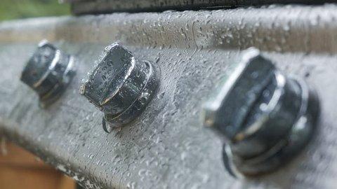 Rain falling on BBQ grill, summer/fall time