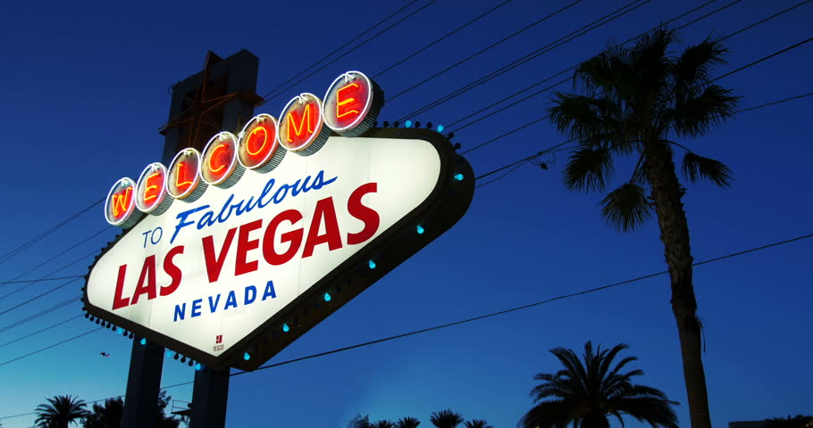 Las Vegas Sign glows against dark blue night sky, welcomes visitors to Las Vegas Strip, Nevada, 2015