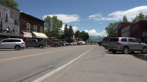 ENNIS, MONTANA - JUN 2015: Ennis Montana main street fuel truck traffic 4K. Center of a long historical ranching economy. Now a tourist destination for trout fishing on Madison River near Yellowstone.