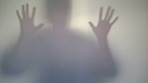 Terrifying male silhouette emerging, flashing, scary gestures. Horror film ghost behind window, monster hallucination, psycho nightmare. Frightening mysterious man shadow, devil concept, aggression