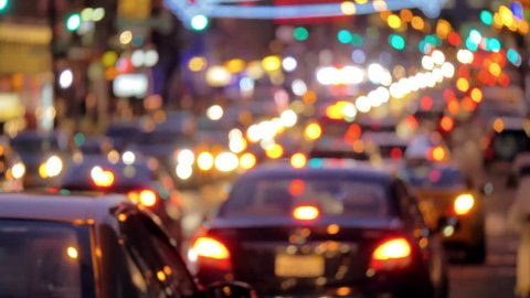 Defocused busy street traffic in New York City at night