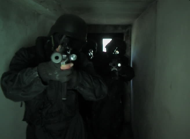 Special Forces running through tunnel