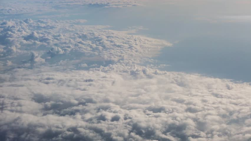 Beautiful fast-sailing clouds on a Sunny day, shooting from aircraft | Shutterstock HD Video #10835909