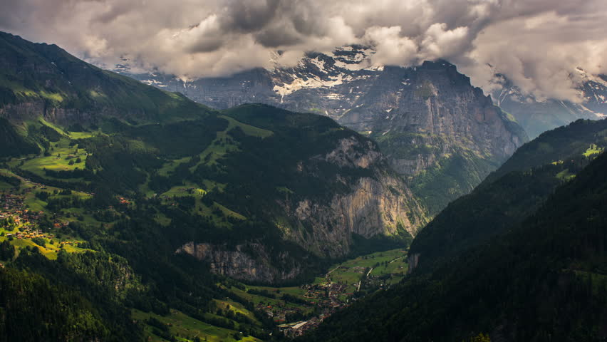 Jungfrau massif and villages on mountainsides, Lauterbrunner, Kleine Sheiddeg time lapse   #10836569