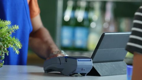Credit/debit card payment with a cashier, close up