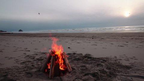 Bonfire Burning on a Beach Rock