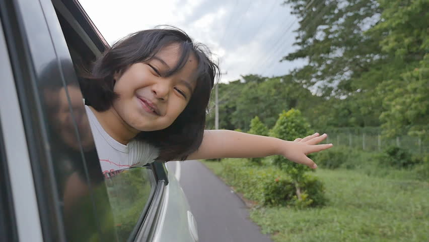 Little Girl Playing on Window Car, Family Traveling on Countryside. #10859459