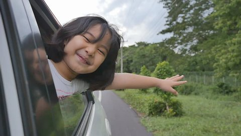 Little Girl Playing on Window Car, Family Traveling on Countryside.