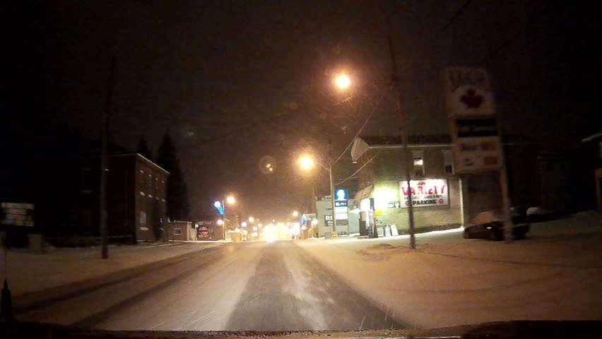 Ontario, Canada January 2014 POV driving at night in the dark low visibility in winter and snow conditions.  | Shutterstock HD Video #10860449