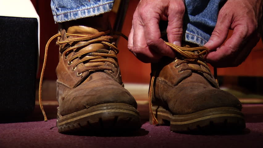 Close up of a man tying his work boots. 1080p HD. | Shutterstock HD Video #10865699