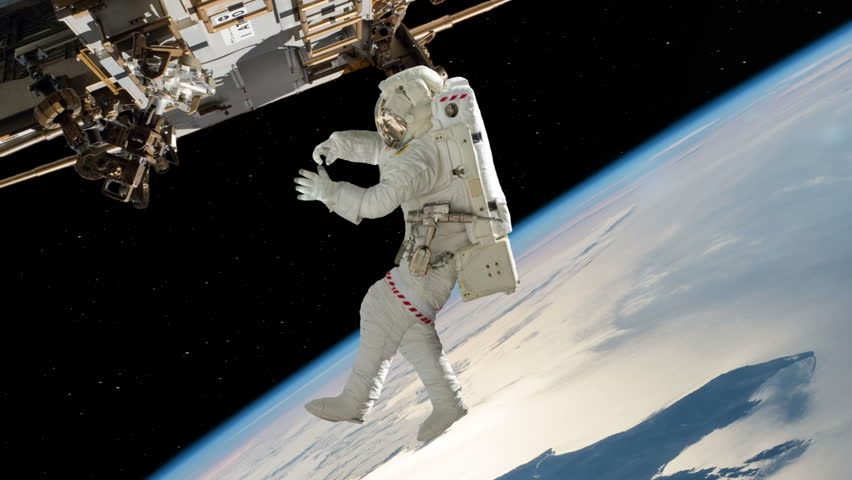 Astronaut Working On International Space Station. Elements of this image furnished by NASA