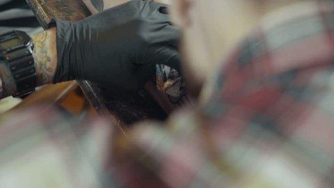 Tattoo artist make tattoo, close up