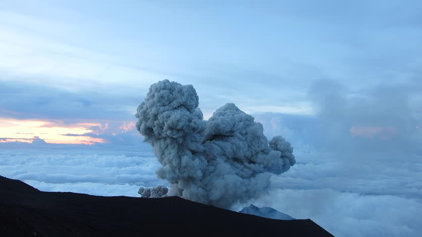 Semeru volcano eruption at Java island in Indonesia. Every 20 minutes volcano erupts cloud of steam and ash.