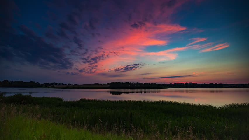 Landscape timelapse of beautiful after sunset sky over lake in Mazury lake district in Poland. 4k UHD