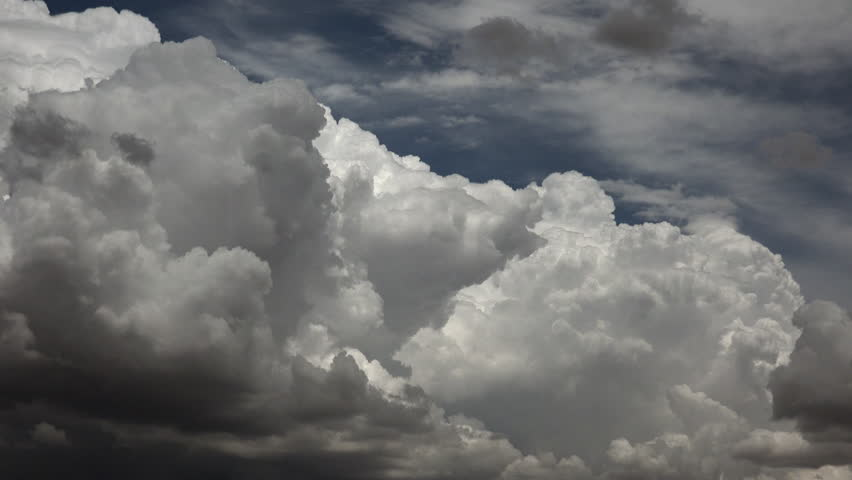Time Lapse, Fast, furious dark, monsoon storm clouds rise dramatically, takeover blue sky. 4K UHD 3840x2160