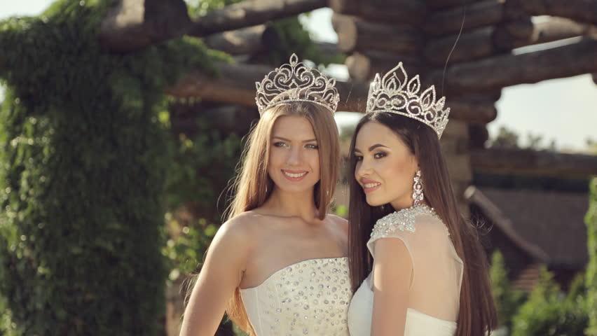 Two Fashionable Girls Dressed In The Bikini And Jewelry