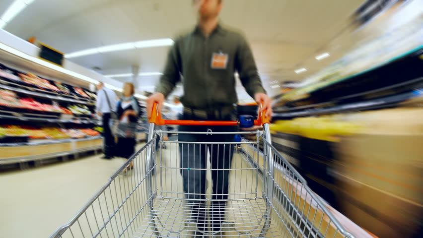 Time Lapse of man pushing empty trolley around supermarket. Footage loops, Camera fixed to Shopping Cart | Shutterstock HD Video #1103359