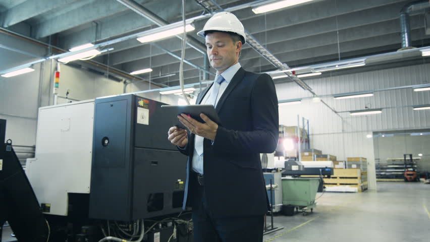 Businessman is Using Tablet PC in Industrial Environment. Shot on RED Cinema Camera in 4K (UHD). | Shutterstock HD Video #11046320